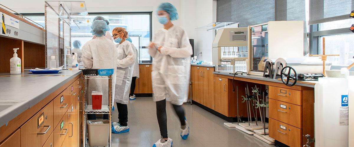 UConn Pharmacy students inside a teaching laboratory
