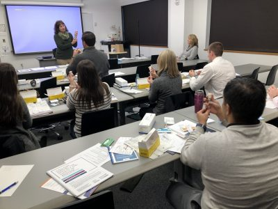 Connecticut community pharmacists learn how to administer a dose of an anti-psychotic drug