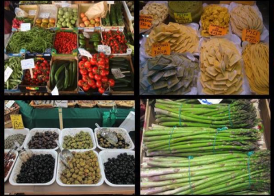 Food choices inside a Florence Italy street market: olives, tomatoes, asparagus, peppers, beans and pasta of many varieties