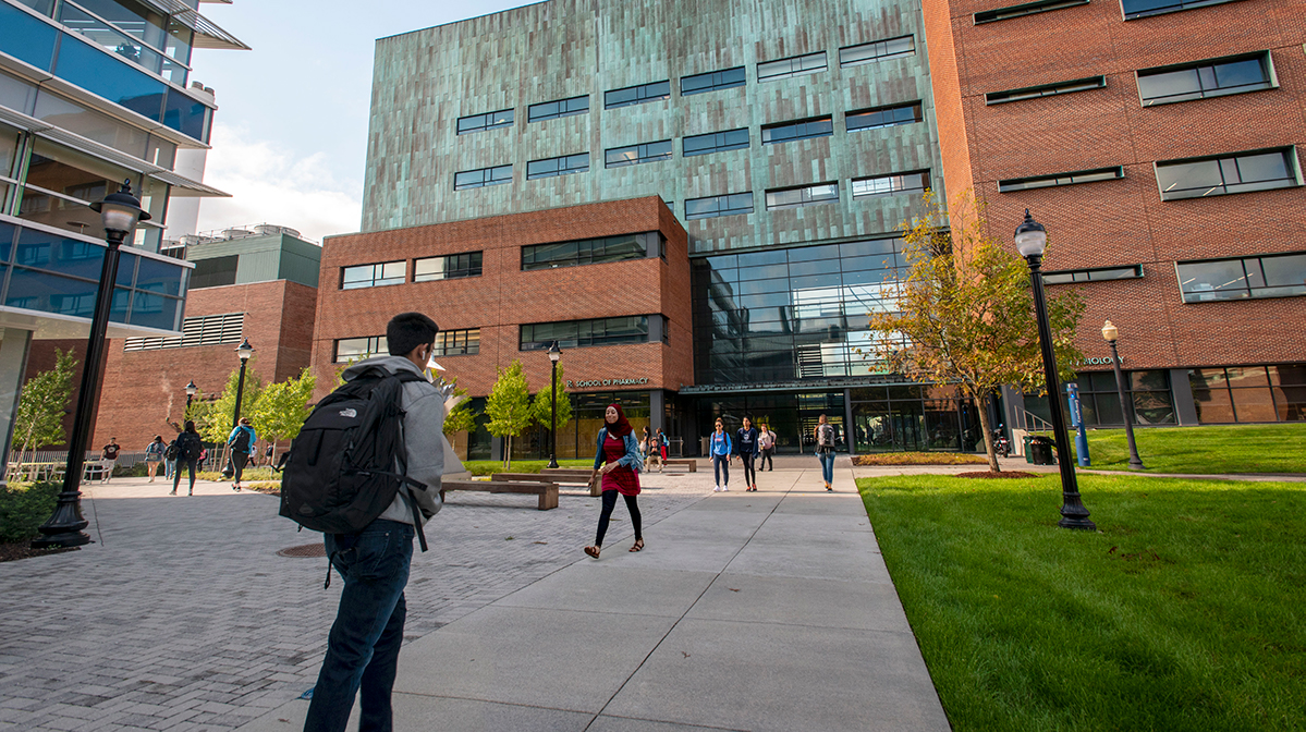 Students walking to and from the School of Pharmacy building on Oct. 3, 2018. (Sean Flynn/UConn Photo)